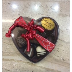 Heart Box Clear Lid 8 chocolates $19.50 Heart Box Clear Lid 8 assorted chocolates Selection may vary Please Click the image for more information.