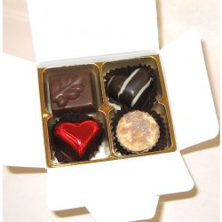 White box - 4 chocolates with one red heart $9.50 Contains 4 chocolates of your choice see The Menu or a ready made assortment including one redfoiled heart Ple. Please Click the image for more information.