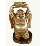 Laughing Buddha statue Small brass finish Laughing Buddha statue holding golden ingot above his headRepresenting wealth Made from stone and resin composite Please Click the image for more information.