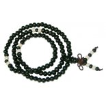 6mm Black wood bead Mala necklace on stretch cord. 6mm Black wood bead Mala necklace on stretch cordwith white spacer beads and smaller black bead in betweenW. Please Click the image for more information.