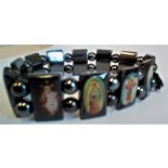 Christian Images Bracelet CatholicChristian Images on magnetic bracelet  The cord is stretchy  The height of the image bead is 18mm. Please Click the image for more information.