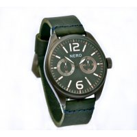 Lisbon. Lisbon watch designed by NERO in the Adelaide hills of South Australia is a charcoal dial retro watch reminiscent of the 1940s with the most stunning dark green  Italian leather band with contrast hand stitchingC. Please Click the image for more information.
