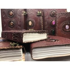 Leather Bound Book with Tooled/Stamped Decoration -Large - 7 Designs Hand Made Leather Bound BookJournal  Large  with a hand tooledstamped cover featuring either a  Buddha Ganesh Dragon Om Tree of Life Pentagram or Elephant design design The book. Please Click the image for more information.