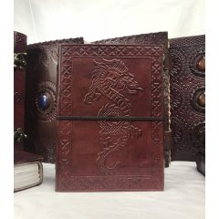 Hand Made Leather Bound Book/Journal -Medium-7 designs Hand Made Leather Bound BookJournal  Medium  with a hand tooledstamped cover featuring either a Buddha Ganesh Dragon Om Tree of Life Pentagram or Elephant design design The book. Please Click the image for more information.